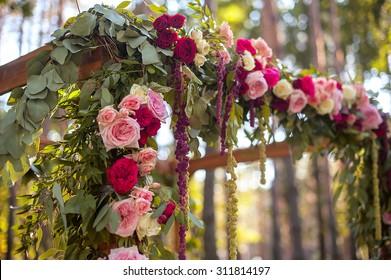 wedding  arch in green forest