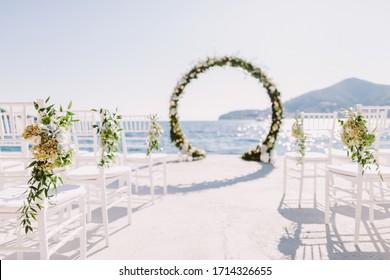 WEDDING ARCH RECEPTION WITH SEA VIEW in Montenegro. White wedding reception venue with sea and mountains view. Destination wedding venue. - Shutterstock ID 1714326655