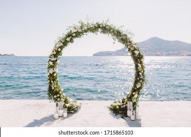 WEDDING ARCH RECEPTION WITH SEA VIEW in Montenegro. White wedding reception venue with sea and mountains view. Destination wedding venue.