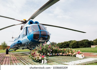 Wedding arch for registration on the helipad. Wedding Canopies against the backdrop of a passenger helicopter. Nobody. Wedding pilot and stewardesses.