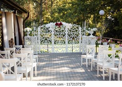 wedding arch, white chairs, wedding registration