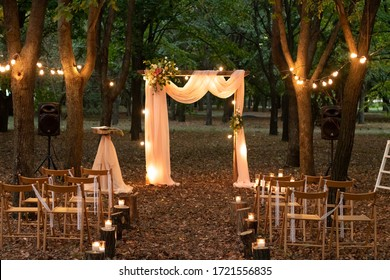 Wedding arch in the woods with light bulbs. Beautiful wedding rustic in the forest. Seats for guests at a beautiful wedding with light bulbs in the forest. - Shutterstock ID 1721556835