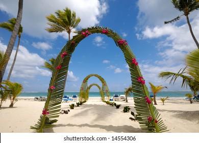 Wedding archway on tropical beach.
