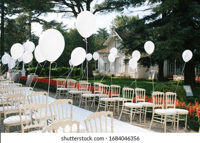 Wedding wedding area chairs and balloons.
