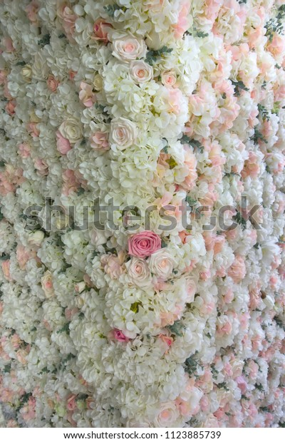 Wedding background of fresh flowers of white and pink roses. Can be used for wedding invitations, engagement, greeting cards and photo Wallpapers. Floral pattern.