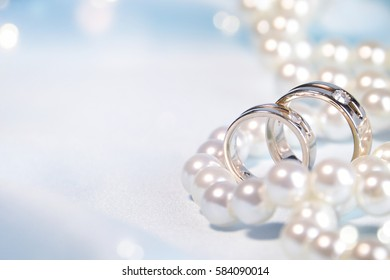 Wedding background with rings and pearls