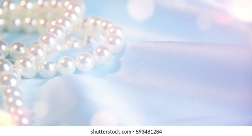 Wedding background. Satin with pearls