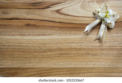 wedding badge for guests on a wooden table