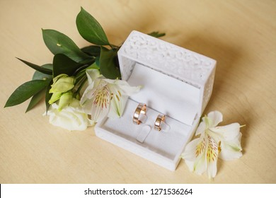 Wedding band in a white box. Two gold band. White velvet box with wedding bands