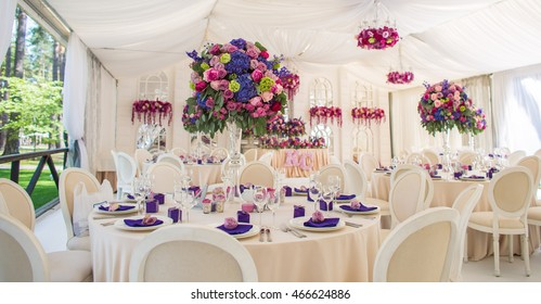 wedding banquet decoration in marquee with roses.