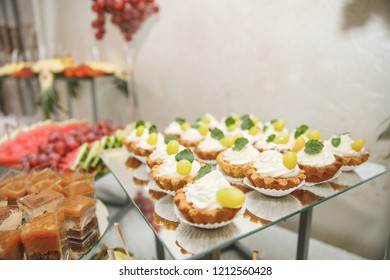 Wedding. Banquet. Dinner concept styled.  Candy bar. Table with sweets, candies, dessert.