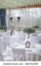 wedding banquet with round tables  and white tablecloths