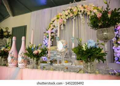 Wedding. Banquet. Table served with cutlery, flowers and crockery and covered with a tablecloth. Wedding decoration