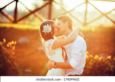 wedding. beautiful couple kissing in the sun