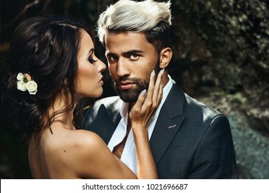 Wedding Beautiful couple sexy Bride dress young girl Brutal groom with beard and gray. Stylish man in costume on the nordic Karelian nature landscape background. Marble Canyon Dramatic sky Karelia