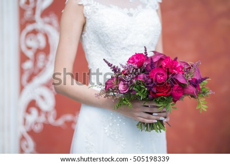 b3d3f3f2cc08 Wedding. Beautiful pink red and Marsala Weding bouquet of different flowers  in the hands of