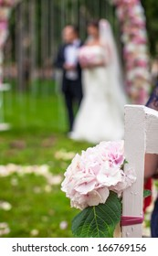 Wedding benches and flower for ceremony outdoors