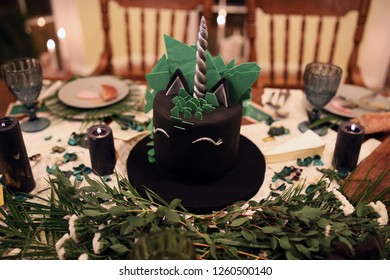 Wedding or birthday cake in form of a green and black unicorn.