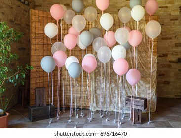 Wedding or birthday photo zone with white, pink and gray balloons in front of wooden screen, free space. Colorful balloons background, pink, white, grey. Holiday concept