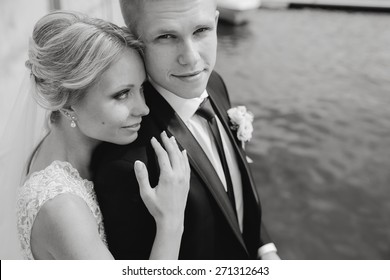 Wedding blond couple walking near the  yachts