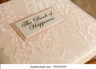 Wedding book for writing best wishes on wedding day. Album for marriage memories for bride and groom. Scrapbook with inscription ''The Book of Happiness''