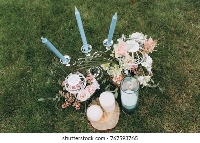 Wedding bouquet, blue candles with a candlestick and glasses with champagne.