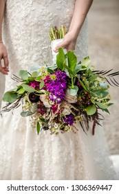 Wedding bouquet in brides hand