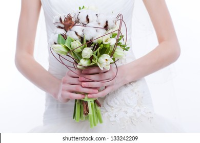 wedding bouquet at bride's hands isolated on white