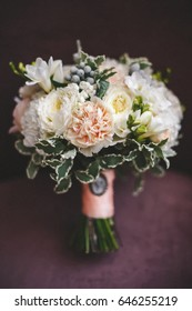 Wedding bouquet in burgundy velvet, bride
