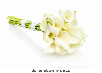 Wedding bouquet, calla lilies, isolated on white background with shadow reflection. Beautiful lily bouquet decorated for bridal on white backdrop.  Marriage lilies for bride on white underlay.
