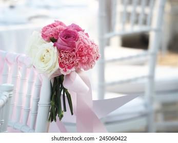 Wedding bouquet in wedding chair vintage color tone