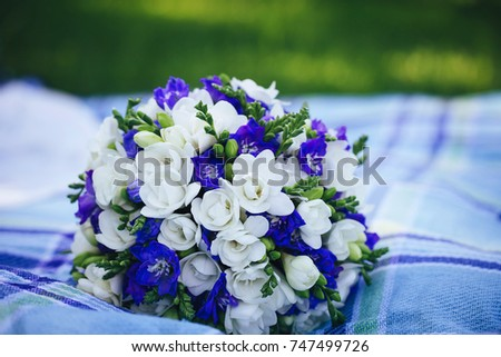 Wedding bouquet flowers blue white petals stock photo edit now wedding bouquet of flowers with blue and white petals mightylinksfo