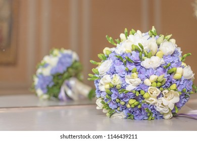 Wedding bouquet flowers bridal bouquet. beautiful white blue bouquet isolated on marble table against mirrow.colorful flowers white and blue freesia and hydrangea. Copy space