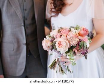 Wedding bouquet, flowers in brides hands