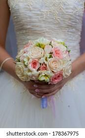 wedding bouquet flowers in hands of the bride