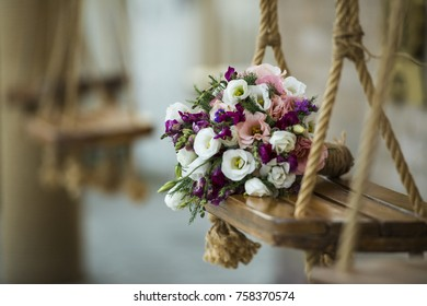 Wedding bouquet of flowers on a wooden swing Wedding Bouquet of Flowers