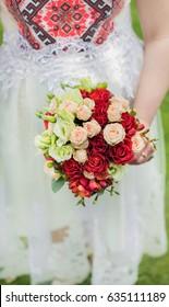 Wedding bouquet in the hand of bride.