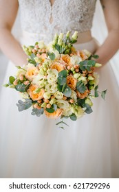wedding bouquet in hands of the bride, Wedding bouquet of fresh flowers, Floristics for a wedding, Bride holding flowers, Flowers for wedding, Festive bouquet, Fresh flowers in a bouquet