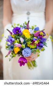 wedding bouquet held by bride - colorful spring fresh bright