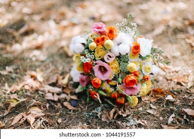 Wedding bouquet laying on the grass. Wedding details