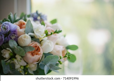 a wedding bouquet lies on the window. vintage toning. Wedding. The bride's bouquet. Wedding bouquet. Green wedding bouquet lying on windowsill
