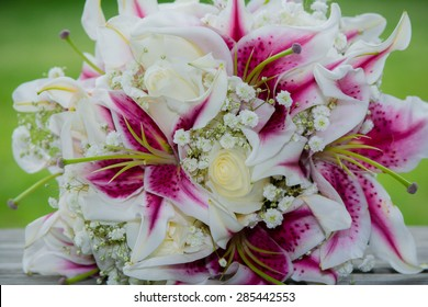 Wedding bouquet of lilies, roses and baby's breath
