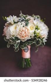 Wedding bouquet on a dark blanket closeup