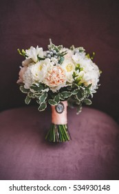 Wedding bouquet on a purple velvet background closeup