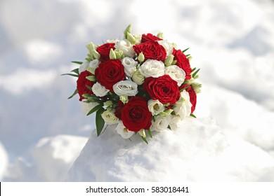 wedding bouquet on snow in winter