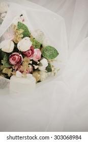Wedding bouquet on veil.