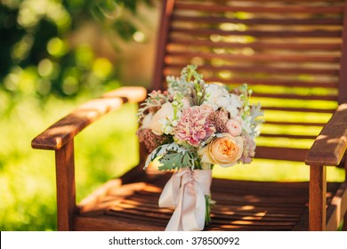Wedding bouquet on a wooden background