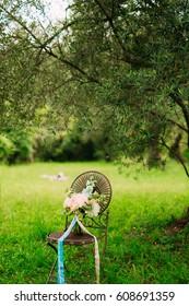 Wedding bouquet of peonies on a vintage metal chair Wedding in Montenegro.
