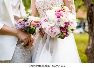 wedding bouquet with peony Wedding bouquet, peonies, roses, in hands