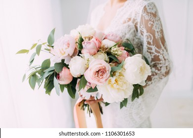 Wedding bouquet of peony and roses